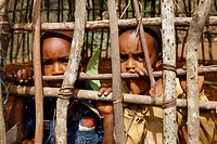 Children behind the framework of a round hut, Mbororo ethnic group, Bamenda, Cameroon, Africa