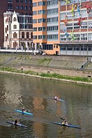 Kayaks in front of office buildings in the Medienhafen Media Port, Rhine, Duesseldorf, North Rhine-Westphalia, Germany