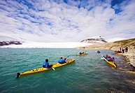 Canoeists on the glacial lake of the Jostedalsbreen glacier, Norway, Scandinavia, Europe