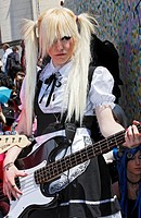 Teenie in Lolita dress playing guitar, Cosplayer summit of young anime and manga fans, Japantag Japan Day, Duesseldorf, North Rhine-Westphalia, German...