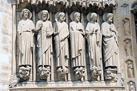 Saint statues, detail on the entrance portal of the Gothic cathedral Notre Dame de Paris, Paris, France, Europe