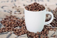 Coffee mug and beans