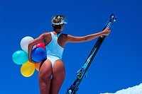 female skier wearing white body, snow bunny wearing body, holding air ballons and skier