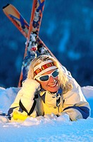 female skier lying in snow, lyin in snow