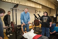 Jackson, Michigan - Tomlinson Education Center, an alternative high school designed for at risk students  Gym teacher Paul Slater helps students with ...