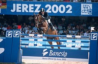 jumping rider Makus Fusch on jumper Tinka´s Boy, jumping over show jump.