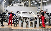 Audi employees assembling the frame of an Audi R8 sports car in the Audi R8 assembly hall, Baden-Wuerttemberg, Germany, Europe