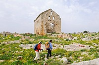 Hikers in front of ruins from the Byzantine era, Dead Cities near Aleppo, Syria, Middle East, Asia
