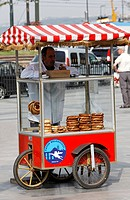 Colorful cars with sesame bread loops, Simit, street vendor, Eminoenue, Istanbul, Turkey