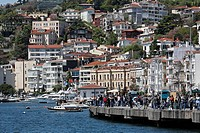 Suburb Bebek with villas at the Bosphorus, many anglers on the promenade, Istanbul, Turkey