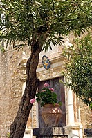 Piazza Duomo with Duomo church, cathedral church and flowers Taormina Sicily Italy