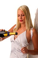 young attractive blond woman as angel pouring a glass of champagne