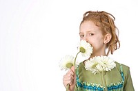Red-haired girl smelling a flower