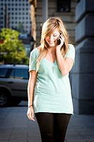 Young woman talking on phone in downtown setting