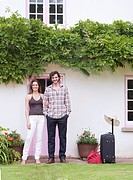 couple by front of house