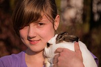 Young girl with a rabbit