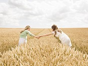 Girls in wheat Field
