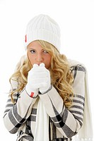 young blonde in gloves, head wear, winter coat and muffler freezing