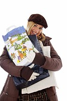 blond in thick clothing carrying Christmas shopping_bags