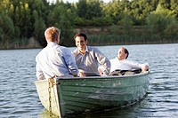 three businessmen relaxing in rowboat