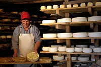 Woman doing cheese called tomme, France