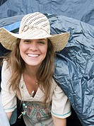 Woman emerging from tent