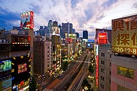 Evening mood in the Yasukuni Dori Avenue in the Shinjuku District, Tokyo City, Japan, Asia