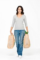 Woman carrying bags, right posture to prevent back ache