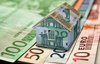 Miniature house and banknotes