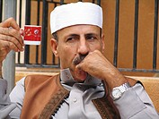 Thoughtful man with teacup and libyan headgear, Libya, Cyrenaica, Benghazi