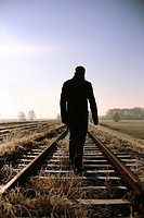 Man on rail tracks, loneliness