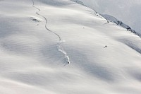 Freestyle skier in terrain covered in deep snow, Northern Tyrol, Austria, Europe