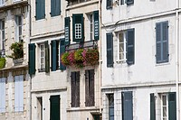 Facade, balcony decorated with flowers, Bayonne, Aquitaine, France