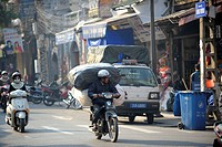 Small mopeds in traffic, Vietnam, Southeast Asia
