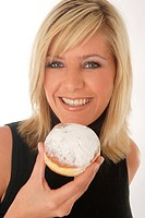 portrait of a young blond woman in black dress, holding a doughnut
