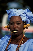 Wolof woman wearing a traditional blue dress, Gambia, Banjul