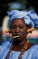 Wolof woman wearing a traditional blue dress, Gambia, Banjul