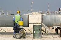Worker on the construction site of Pearl GTL, Gas to Liquid, where the Shell company are constructing until 2010 the world-wide largest refinery for t...