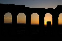Roman ruins, silhouette at sunset in Volubilis, Moulay Idris, Morocco, Africa