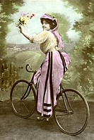 Historical photo, woman on bicycle, ca. 1910