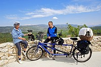 Couple with tandem and Miniature Schnauzer, black_silver, Provence, France, Europe