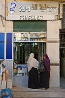 Women in front of a pharmacy, Aswan, Egypt, Africa