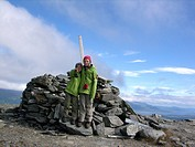 children at cross on a summit of a mountain, Sweden, Abisko
