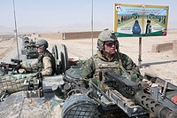 Dutch military on patrol in tarin kowt town, Uruzgan  The Dutch ISAF forces, together with the Australian forces control Tarin kowt town and Derahwod ...