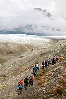 Kennicott, Alaska - People hike towards Root Glacier in Wrangell-St  Elias National Park, where they will learn ice climbing