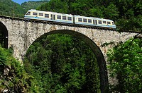 Centovalli train crossing a viaduct in Centovalli, Canton Ticino, Switzerland, Europe