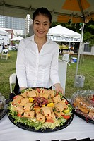 Florida, Miami, Bayfront Park, Mercedes-Benz Miami Corporate Run, community charity event, Asian, woman, caterer, set up, food, wraps, tray,