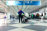 young businessman with luggage cart calling in an airport_terminal