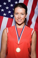 Sportswoman wearing a medal