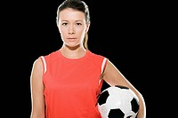 Female footballer holding a football